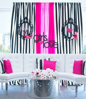 Curved White Tufted Banquettes with Mirrored Round Coffee Table with Pink & Black accents